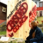 Gallery owner Vesna Tenodi with the offending stone sculpture encased in a pine crate with protest messages